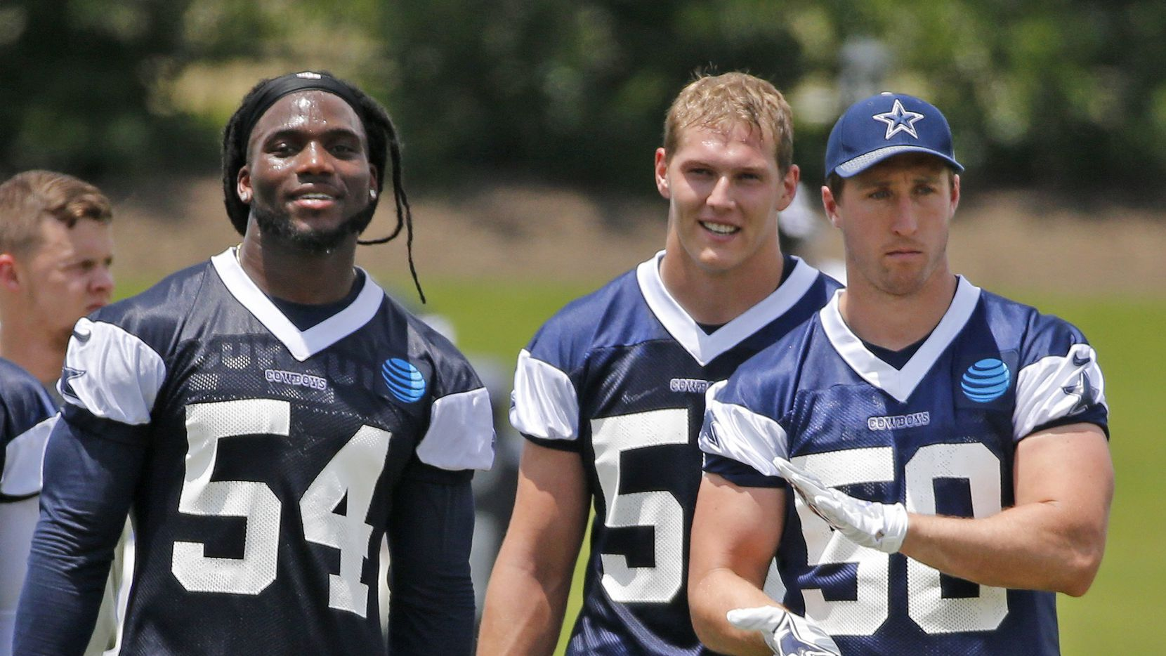Dallas Cowboys linebackers Jaylon Smith (54), Leighton Vander Esch (55) and Sean Lee (50) are pictured together during Dallas Cowboys OTA football practice at the Star in Frisco on Wednesday, May 23, 2018. (Louis DeLuca/The Dallas Morning News)