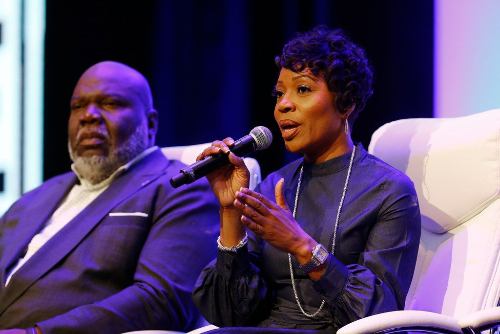 Dallas Police Chief U. Renee Hall speaks next to Bishop T.D. Jakes during the Blue on the Block community meeting at The Potter's House in Dallas on Saturday
