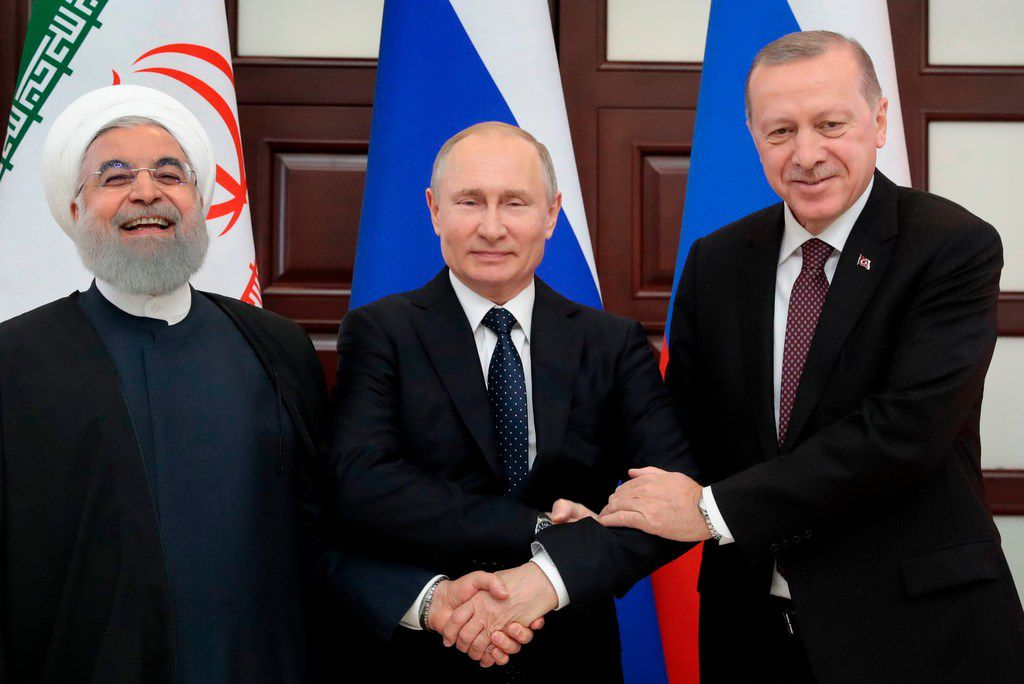 Iranian President Hassan Rouhani (from left),  Russian President Vladimir Putin and Turkish President Recep Tayyip Erdogan posed prior to a trilateral meeting on Syria in the Black Sea resort of Sochi on Feb. 14, 2019.
