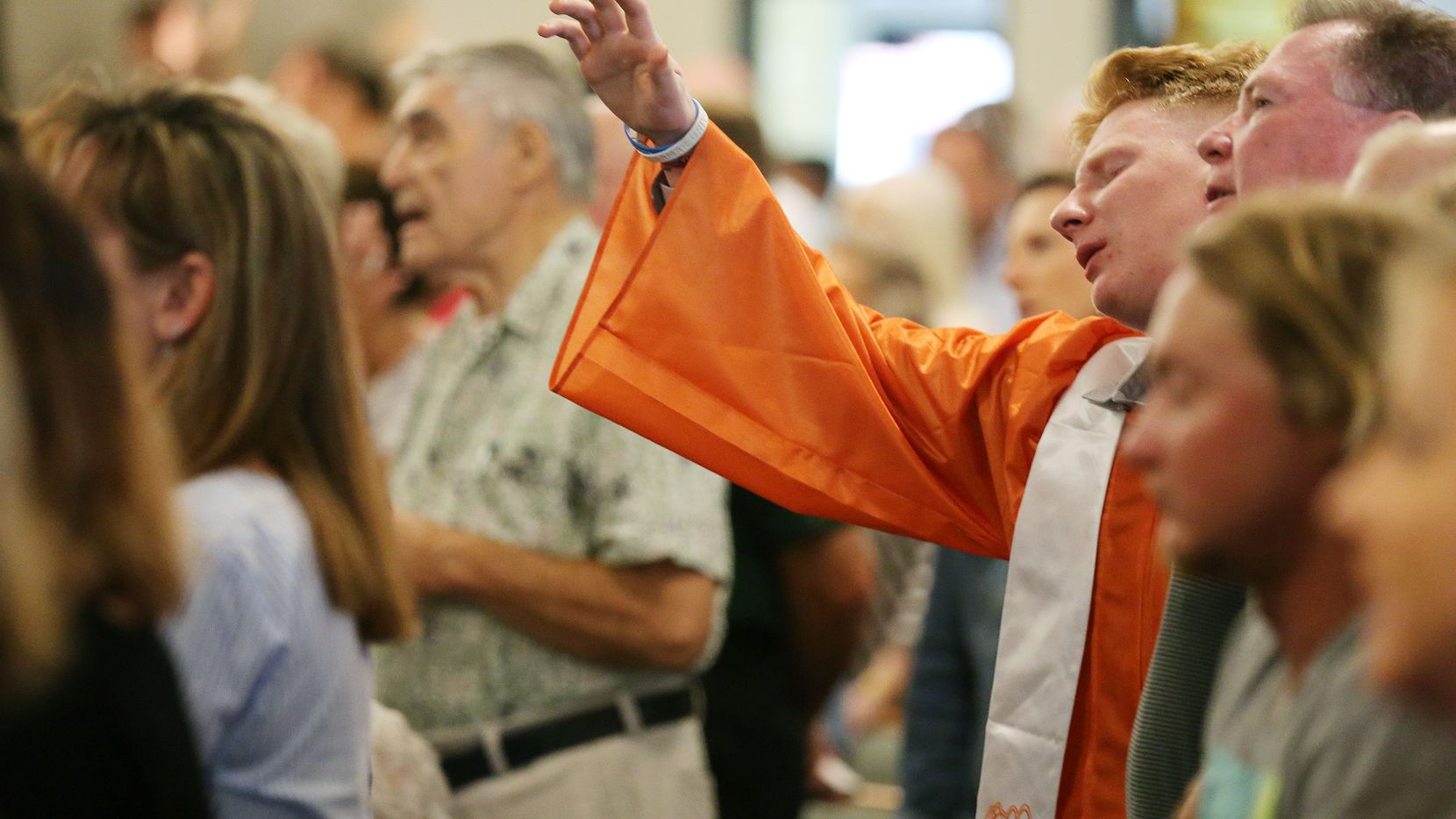 After being recognized with other graduating high school seniors, a student worships during service at Arcadia First Baptist Church in Santa Fe, Texas.