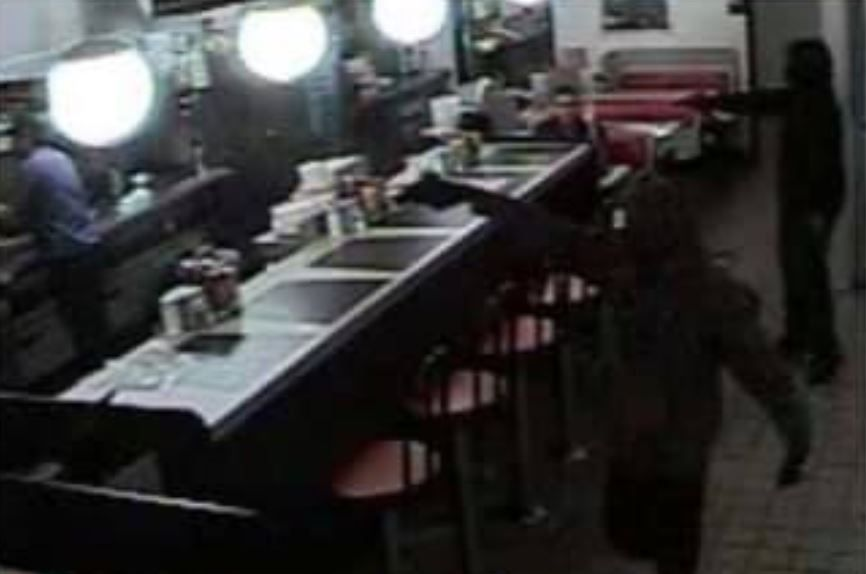 A pair of gunmen robbed a Waffle House in Bedford earlier this month, and police are asking for help identifying them.