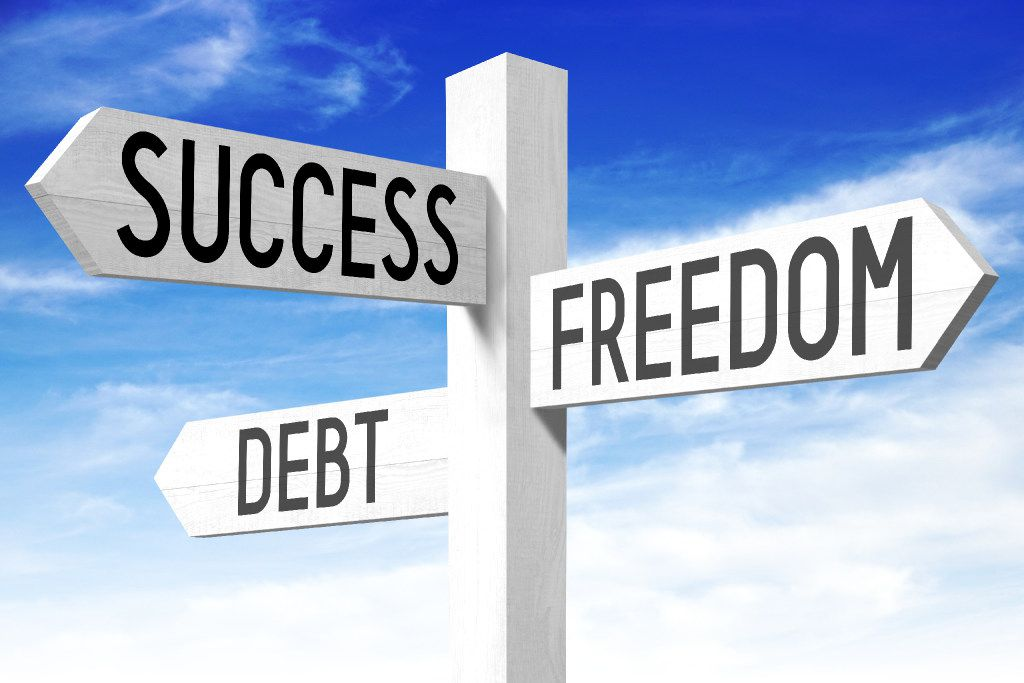 """Success, freedom, debt illustration White wooden signpost/ crossroads sign with three arrows - """"success"""", """"freedom"""", """"debt""""."""
