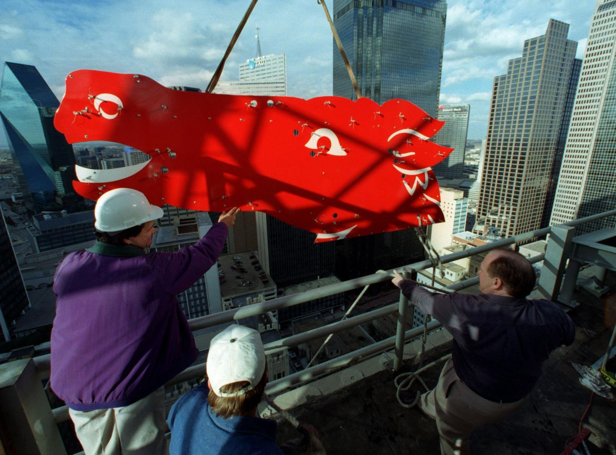 Sam Hanson (left) holds the head of Pegasus as Benton Byrum (center) and Warren Casteel, project manager, work on installing the new flying horse on the roof of the Magnolia Hotel in downtown Dallas, prior to its completion in time for the city's New Year's Eve celebration at the end of 1999.