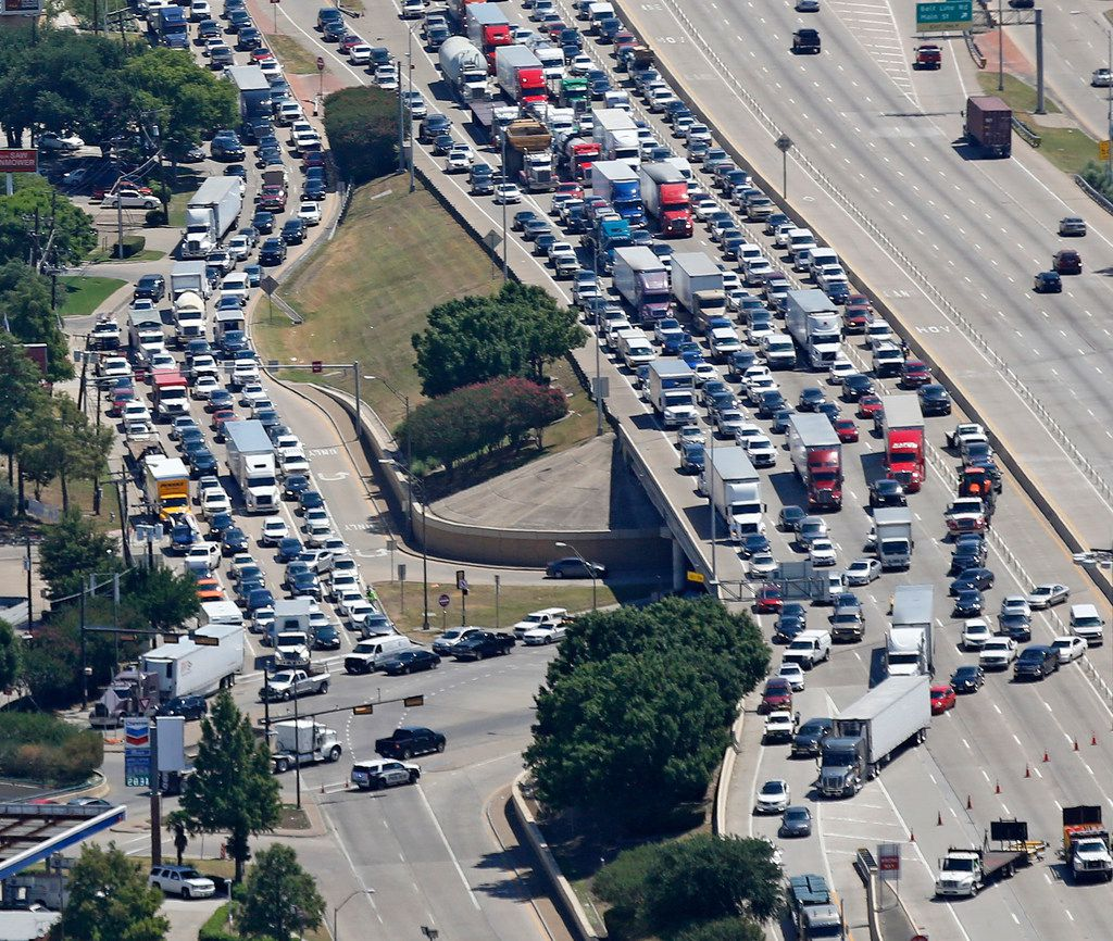 Motorists try to exit to southbound Highway 75 at the Midpark exit, as the access road stacks up to travel on Spring Valley Road after the Intersection of Interstate 635 and Highway 75 north of downtown Dallas was closed because of an overturned truck carrying hazardous materials.