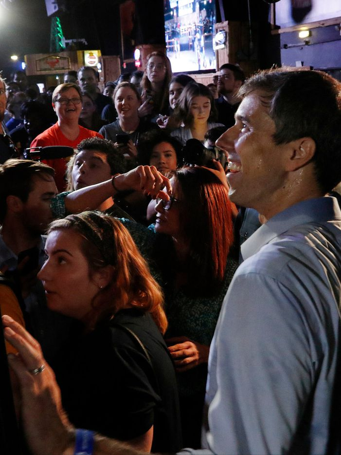 Beto O'Rourke talks to voters after a rally at the Houston Stampede Event Center in Houston Texas, on Saturday, September 8, 2018. Ted Cruz campaigned in Humble, Texas, Texas on Saturday, while Beto O'Rourke campaigned a few miles away in Houston, Texas.