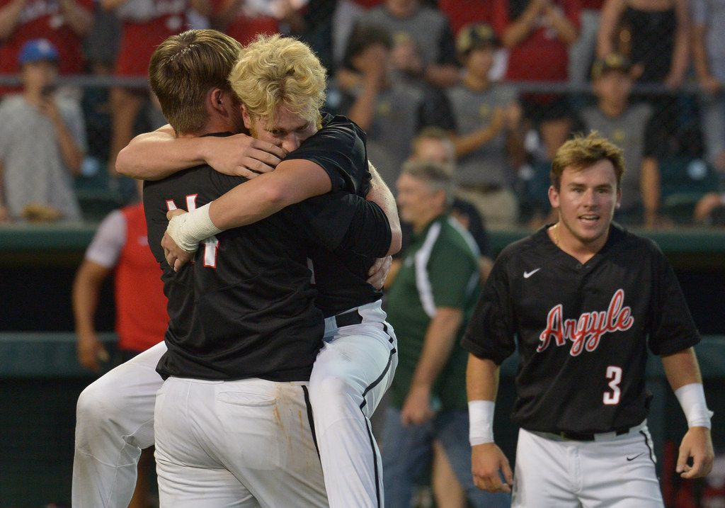 Argyle Eagles pitcher Bryson Hudgens (14)  celebrating with Argyle Eagles centerfielder Dillon Carter (1) after pitching a complete game during the UIL Class 4A state championship game between the Sweeny Bulldogs and the Argyle Eagles at UFCU Disch-Falk Field in Austin, Texas, Thursday, June 7, 2018. Argyle defeated Sweeny, 5-0 winning the Class 4A state championship game. (Patrick Green/DRC)
