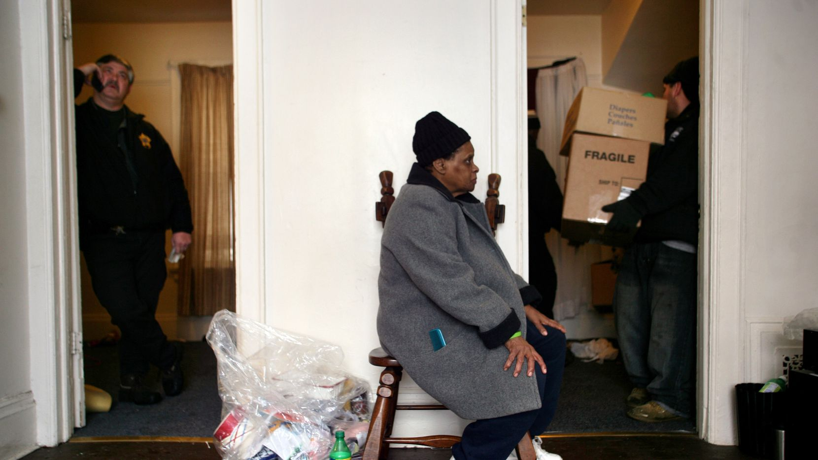 Gloria Rhodes, 64, watches as employees of Eagle Moving and Storage Company remove the furniture and belongings from the apartment she shared with her daughter, Ara Sparkman in Milwaukee, Wis., in February 2010. Here and in swaths of many cities, evictions from rental properties are so common that they are part of the texture of life. But new research is showing that eviction is a particular burden on low-income black women, often single mothers, who are more likely than men to rent apartments and more vulnerable to losing them, in part because their wages or welfare payments have not risen with the cost of housing. And evictions can easily throw families into cascades of turmoil and debt. (Sally Ryan/The New York Times)