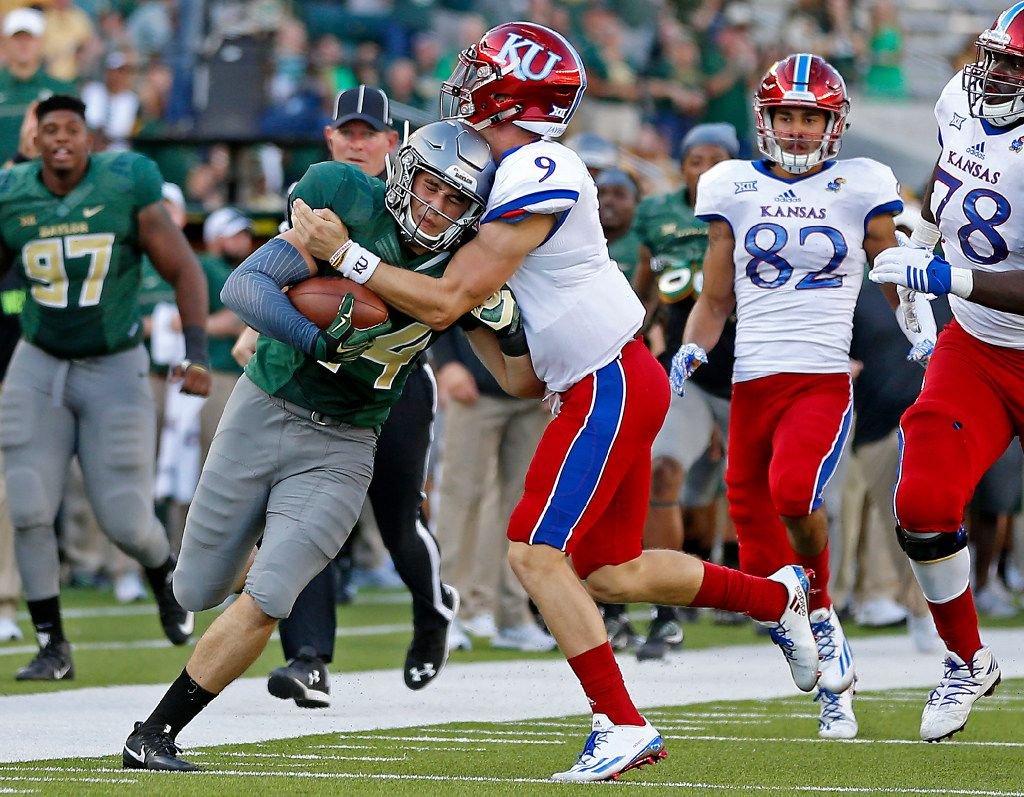 Baylor linebacker Clay Johnston (44) is tackled by Kansas quarterback Carter Stanley (9) while returning an interception during the fourth quarter at McLane Stadium in Waco, Texas, Saturday, Oct. 15, 2016. Baylor won 49-7. (Jae S. Lee/The Dallas Morning News)