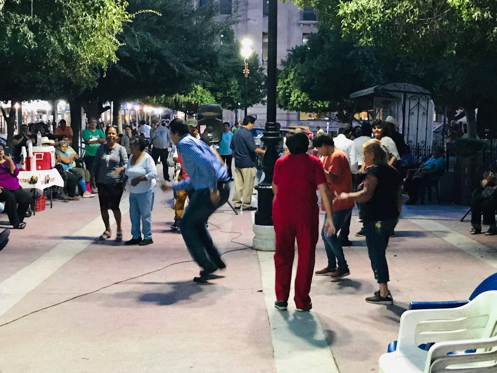 Amid the rising crime, growng economic uncertainty, life goes on in Torreon, Coahuila where Mexicans turn out for community event that includes dancing. Lorena Maciel Rodriguez, far right, explains she's not ready to give up on new president.