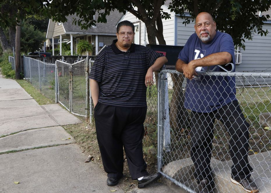 Ronnie Mestas (right), president of West Dallas 1, and Raul Reyes stand in front of Mestas's home. They believe the best way to take care of the neighborhood is to back its public schools.