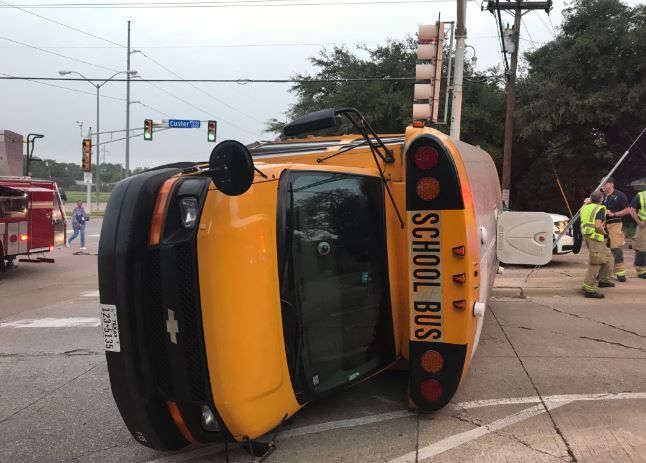 A school bus lies overturned in Richardson on Friday morning after hitting a vehicle. No one on the bus or in the other vehicle was injured.