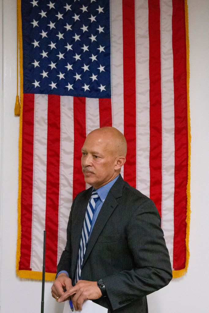 Newly elected District Attorney John Creuzot walks away after his swearing-in ceremony in January.