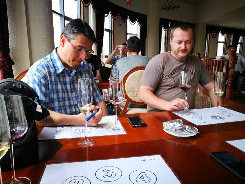 Tourists from the Czech Republic compare Chinese wines on their wine tour from Easy Tour China.