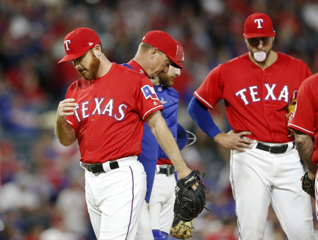 Rangers relief pitcher Sam Dyson (47) exits the mound after manager Jeff Banister (28) pulled him in the ninth inning in a game against the Cleveland Indians on opening day  on Monday, April 3, 2017..