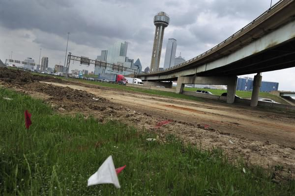Roadwork continues near the intersection of Interstate 30 and I-35E, west-southwest of downtown Dallas, in the area of land transactions sold by Kevin Bollman and Wade Blackburn to the Texas Department of Transportation.