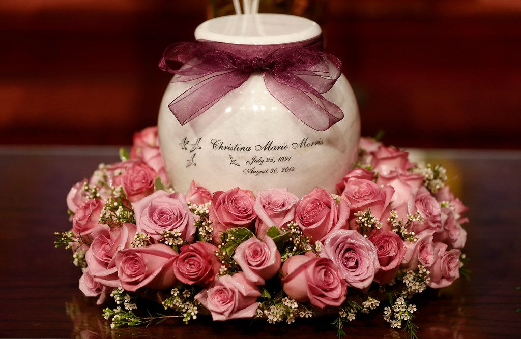 An urn with Christina Morris' ashes sits on the table before a memorial service at First Baptist Church in Allen, Texas, on Saturday, April 21, 2018.