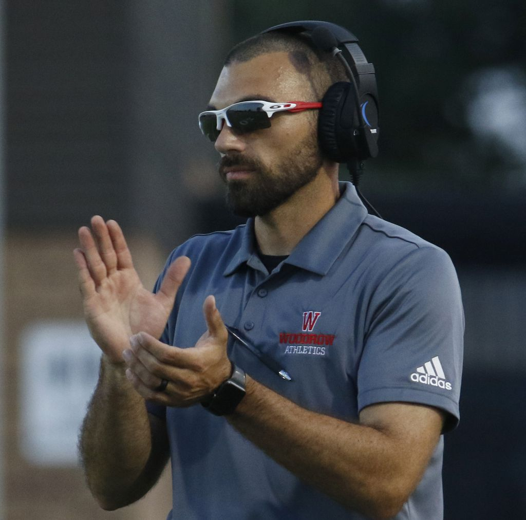 Dallas Woodrow Wilson head coach Tony Benedetto applauds a touchdown during first half action against Frisco. The two teams competed in their season-opening non-district football game at Franklin Stadium in Dallas on August 29, 2019. (Steve Hamm/ Special Contributor)