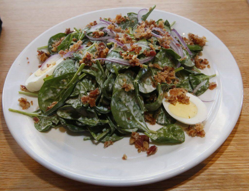 Spinach and Bacon salad photographed Monday December 14, 2015, from the lunch menu of the new Coal Vines located across from the Omni Dallas Hotel. Fresh baby spinach tossed with farm fresh hard boiled eggs, applewood smoked bacon bastioned red onion with a house made buttermilk ranch dressing. (Ron Baselice/The Dallas Morning News)