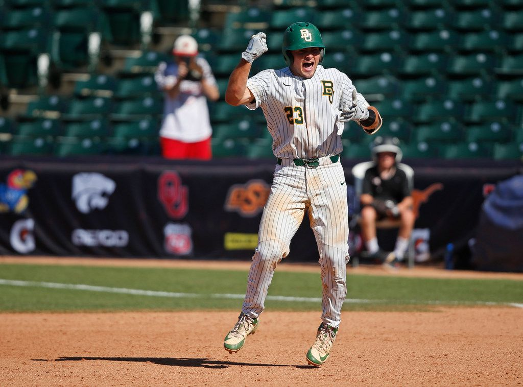 Baylor catcher Shea Langeliers (23) celebrates after hitting in the game winning run against TCU in the championship game of the Big 12 baseball tournament game in Oklahoma City, Sunday, May 27, 2018. Baylor won 6-5 in eleven innings. (AP Photo/Sue Ogrocki) ORG XMIT: OKSO