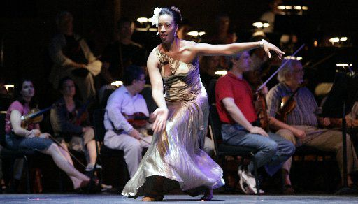 Melissa M. Young performs with the Dallas Symphony Orchestra during her tenure as a dancer at Dallas Black Dance Theatre. Young has been with the company for 25 of its 42 years and has been named its new artistic director.