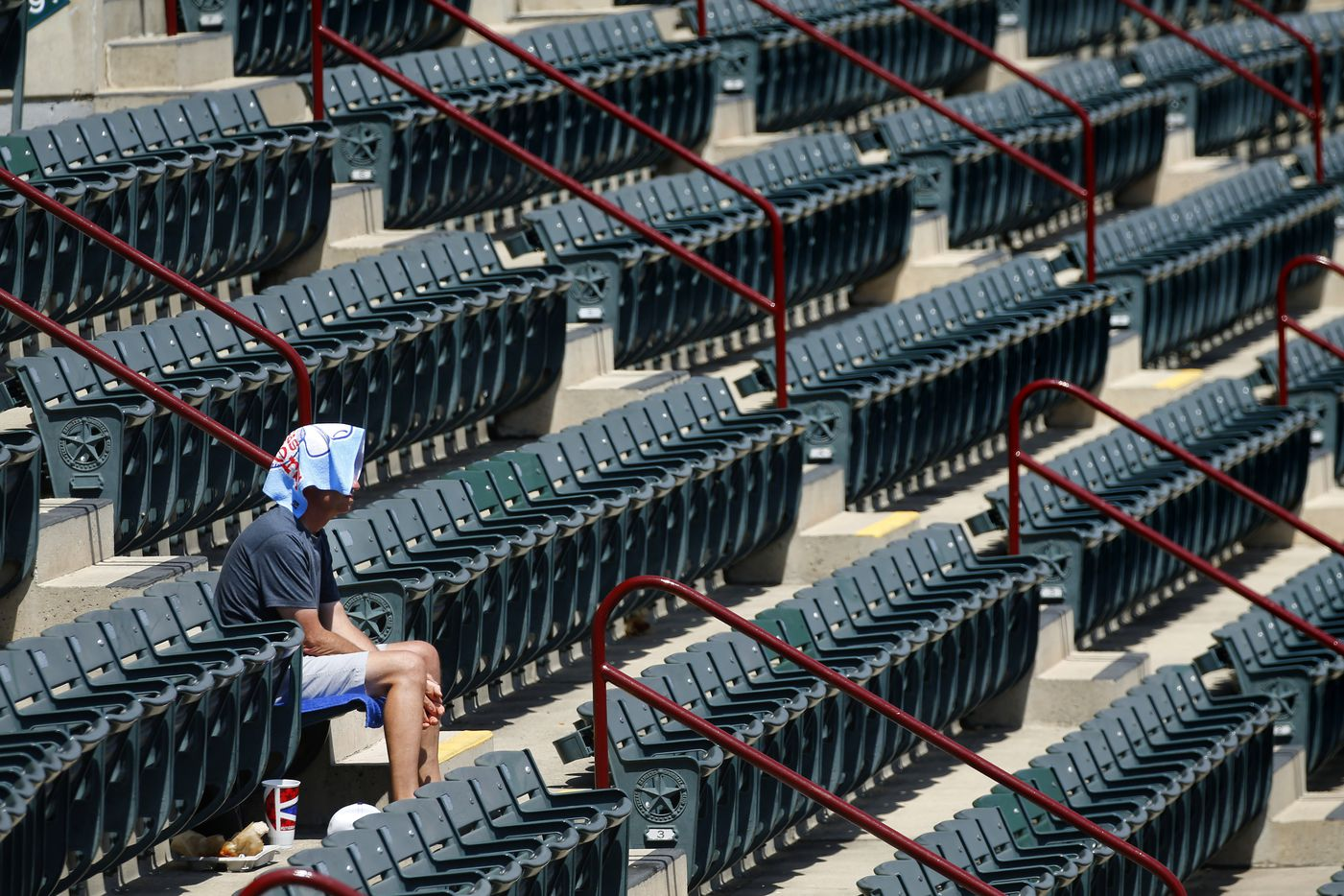 Optimists and pessimists can agree: based on official attendance numbers, Globe Life Park was less than half full, leaving Texas Rangers fan Don Scheibel of McKinney with several sections to himself in the upper concourse as temperatures climbed to 108 at Globe Life Park in Arlington, Sunday, July 22, 2018.