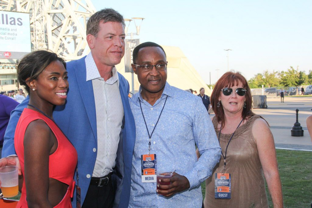 Former Dallas Cowboys player Troy Aikman posed with fans at Taste of the NFL.