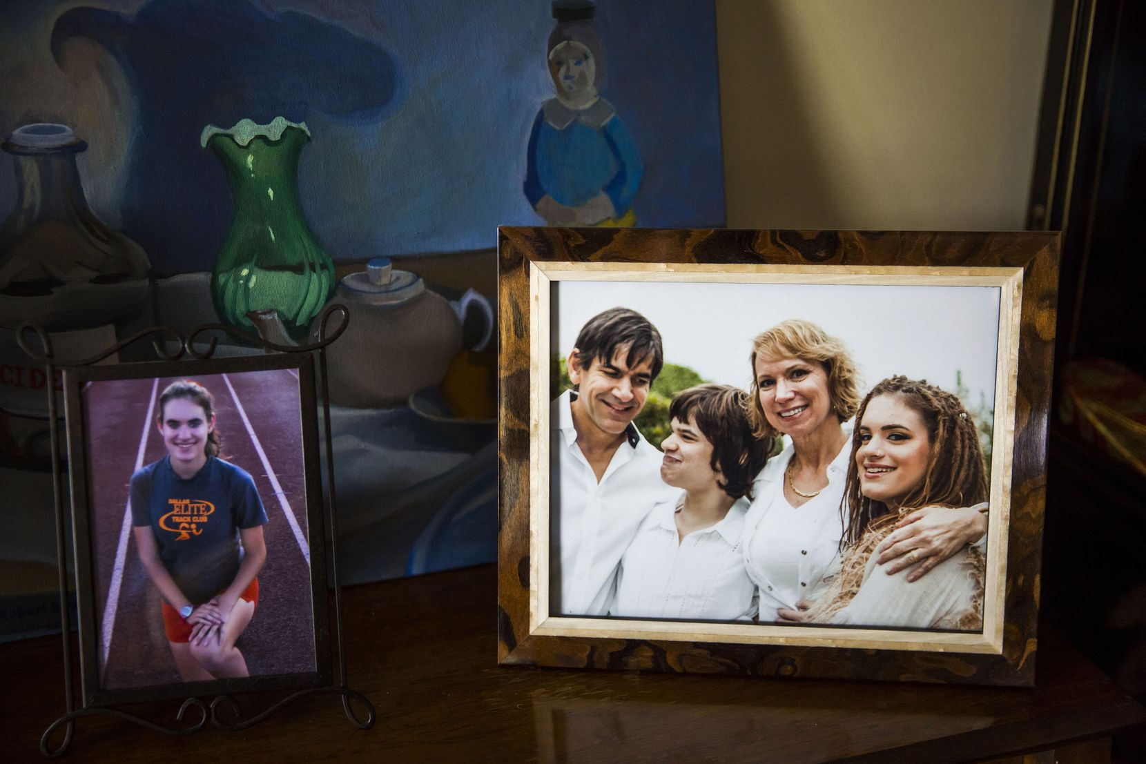 A framed photo in the family's home shows the Zartlers and their twin daughters. (Smiley N. Pool/The Dallas Morning News)