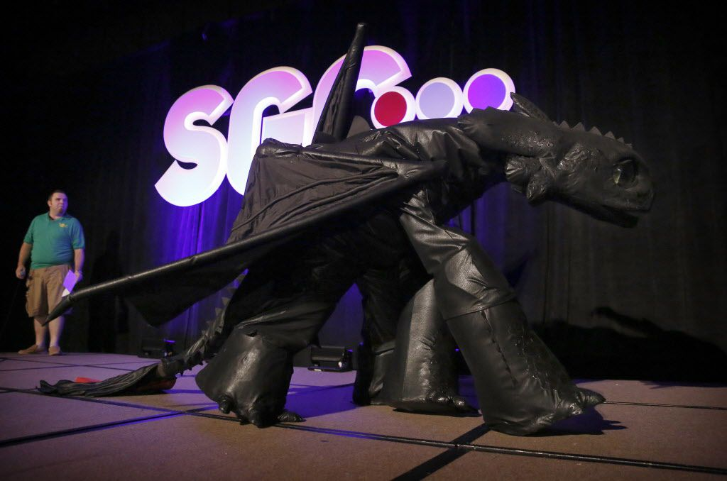 """Bryce Eden of Arlington dressed as Toothless from """"How to Train Your Dragon"""" in the cosplay contest."""
