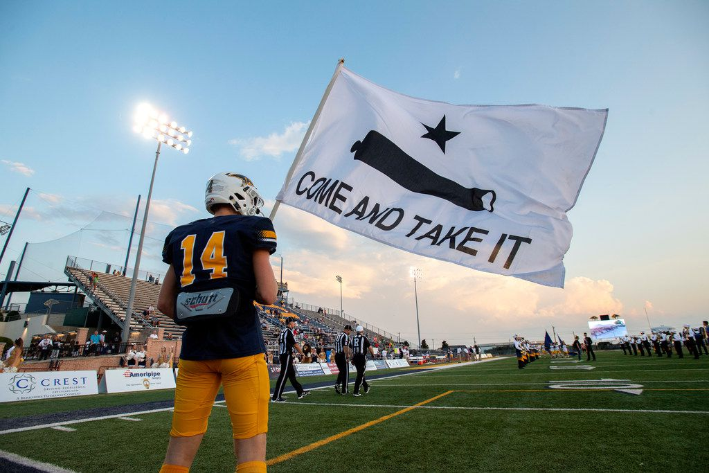"""Plano Prestonwood Christian senior wide receiver Dayton Toney waves a """"Come And Take It"""" flag before a high school football game against Fort Worth All Saints on Friday, October 4, 2019 at Lions Stadium Plano, Texas. (Jeffrey McWhorter/Special Contributor)"""