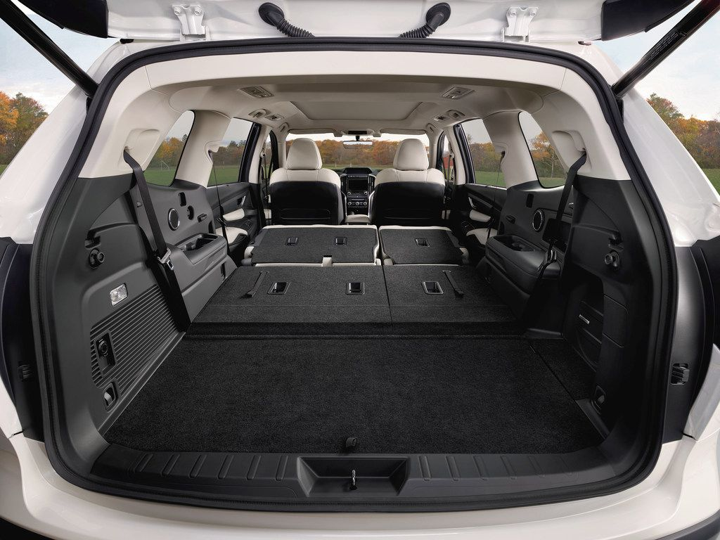 The cargo area is wide on top and bottom, and the roof rails can support a roof tent