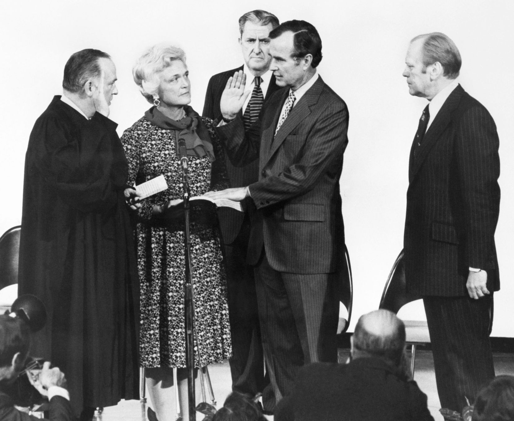 1976: George H.W. Bush (second from right) is sworn in as CIA diretor by Associate Supreme Court Justice Potter Stewart in Washington, D.C., as his wife, Barbara Bush, CIA's vice director Vernon Walters (background) and President Gerald Ford watch.