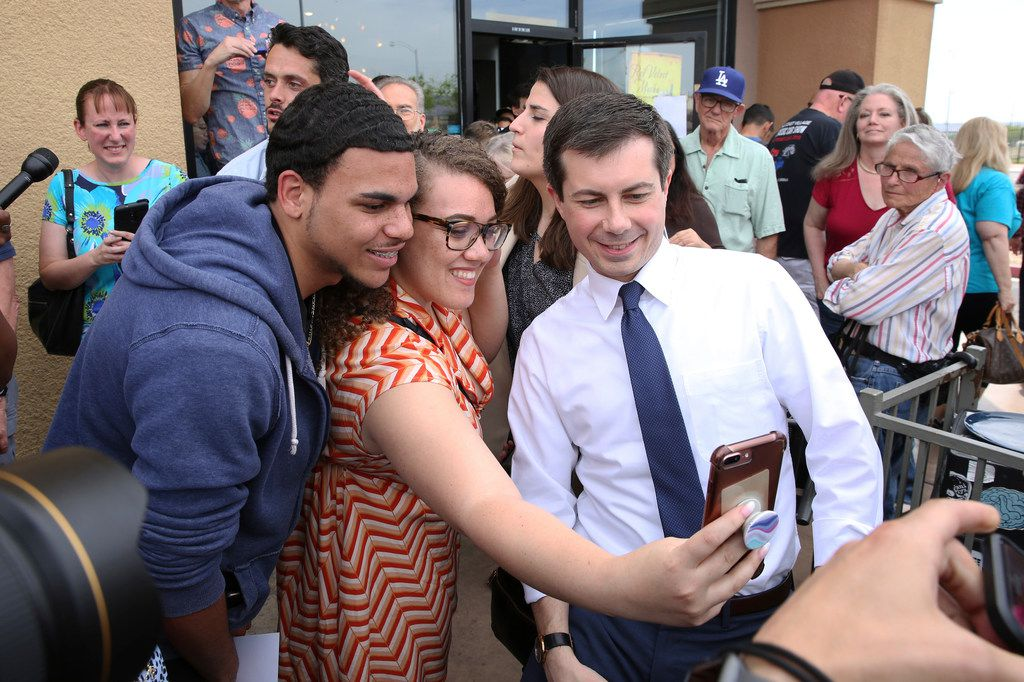 South Bend, Ind., Mayor Pete Buttigieg (right) posed for a selfie with Cameron Mitchell and Brooklyn Williams after speaking Monday at a meet-and-greet at MadHouse Coffee in Las Vegas.