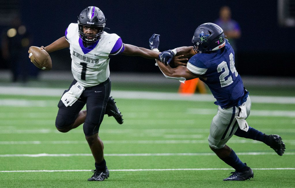 Frisco Independence quarterback Braylon Braxton (1) fends off Frisco Lone Star linebacker Jaylan Ford (24) during the second quarter of a District 5-5A Division I high school football game between Frisco Independence and Frisco Lone Star on Thursday, October 10, 2019 at the Ford Center at The Star in Frisco. (Ashley Landis/The Dallas Morning News)