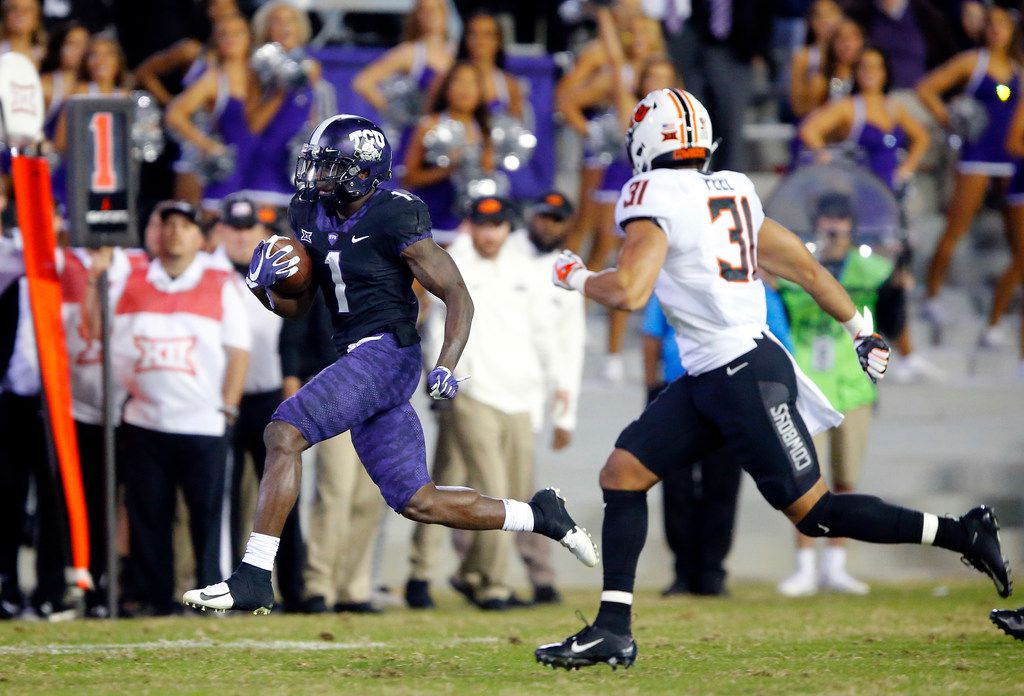 FILE - TCU Horned Frogs wide receiver Jalen Reagor (1) breaks away from Oklahoma State Cowboys safety Kolby Peel (31) after a fourth quarter catch  at Amon G. Carter Stadium in Fort Worth, Texas, Saturday, November 24, 2018. The Frogs hung onto win, 31-24. (Tom Fox/The Dallas Morning News)