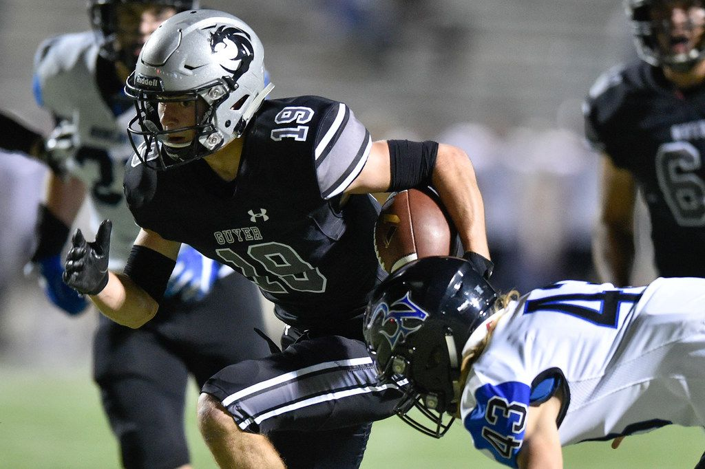 Guyer wide receiver Seth Meador (19) catches a pass and is tackled by Nelson's Nick Kellogg (43) at C.H. Collins Athletic Complex.