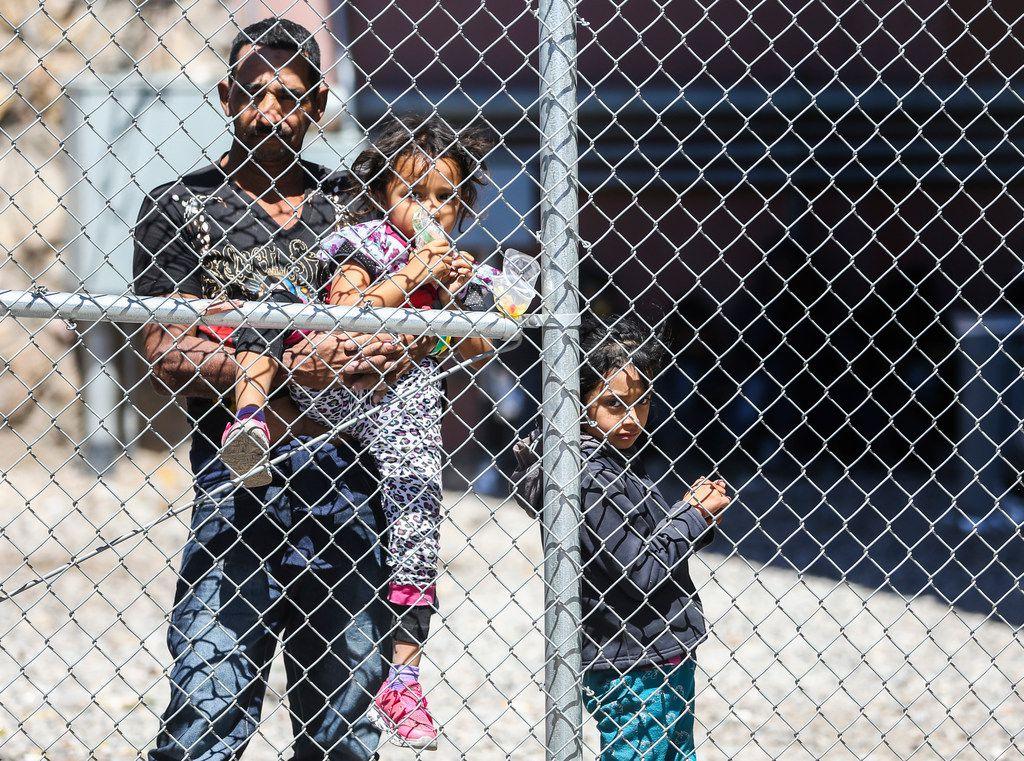 Migrants seeking asylum are held in a temporary transition area under the Paso Del Norte bridge in El Paso, Texas, on March 28, 2019.