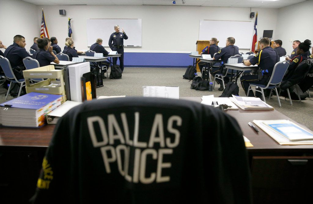 Deputy Chief Jeffrey Cotner, now retired, taught an excellence in policing class to a room of recruits at the Dallas Police Department's training facility in May.