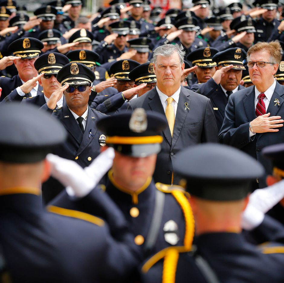 (from left) Dallas police Chief David Brown (facing with sunglasses), Dallas Mayor Mike Rawlings  and Texas Lt Governor Dan Patrick watch as the Dallas Police Honor Guard salutes carries the flag-draped casket of Dallas police officer Michael Krol outside of Prestonwood Baptist Church in Plano, Texas, Friday, July 15, 2016. Krol was gunned down in an ambush attack in downtown Dallas a week ago. Four Dallas police officers and one DART officer were killed and several survived. (Tom Fox/The Dallas Morning News, pool photo)