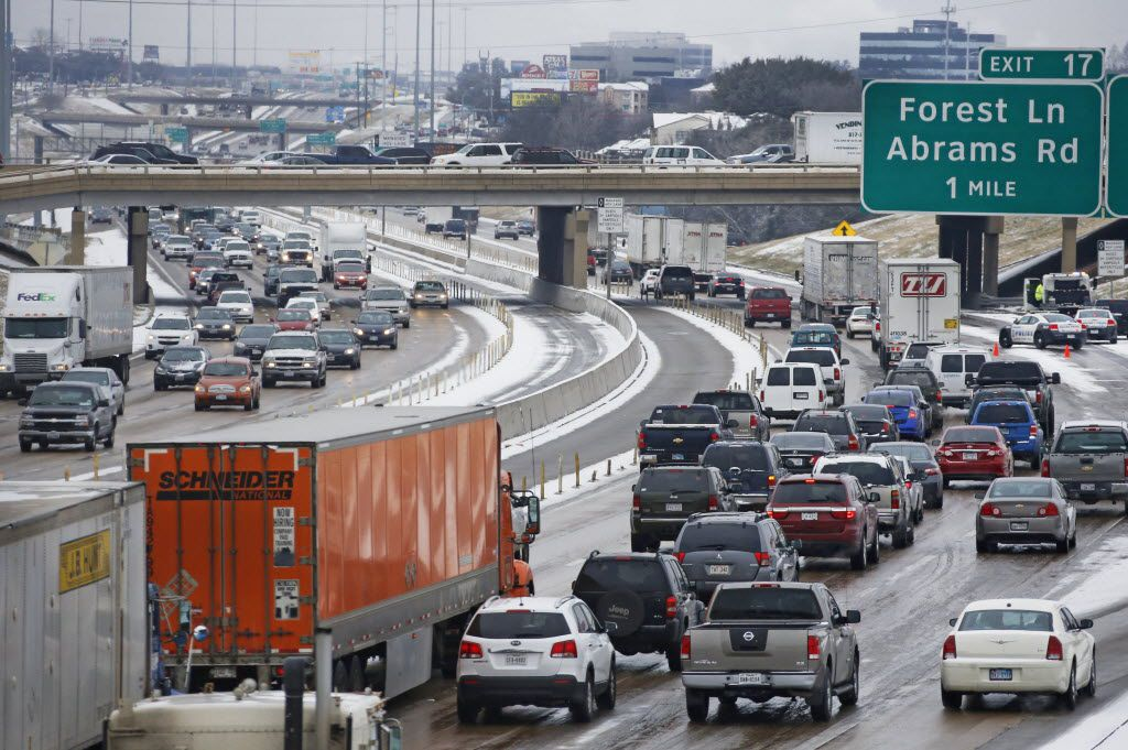 Traffic stacks up on LBJ 635 as police work an accident at the Skillman exit going westbound in northeast Dallas on Thursday, February 6, 2014.  (Louis DeLuca/Dallas Morning News) 03092015xNEWS