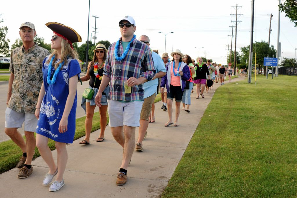 Parrotheads walk to the Jimmy Buffett concert at Toyota Stadium in Frisco, TX on May 30, 2015.