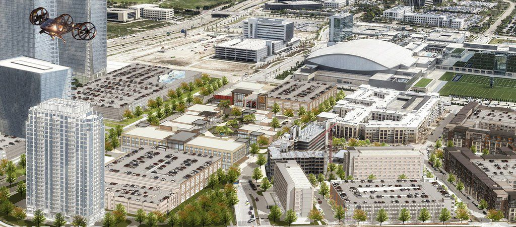 An architect's rendering of Frisco Station shows the Hub district in the center and office towers on the tollway.