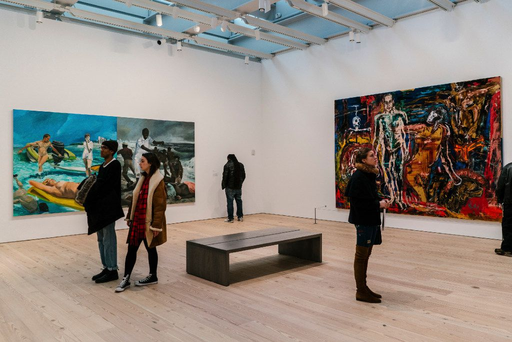 Eric Fischl, whose artwork will be featured in the 2017 MTV Re:Define event in Dallas, created the piece on the left in this photo, taken at the Whitney Museum of American Art in January. (Jake Naughton/The New York Times)