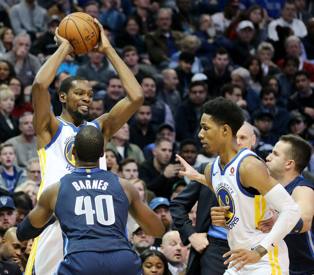 Golden State Warriors forward Kevin Durant (35) attempts to move the ball in the third quarter during a National Basketball League game between the Golden State Warriors and the Dallas Mavericks at the American Airlines Center in Dallas Wednesday January 3, 2018. Warriors led the Mavericks 67-61 at the half. (Andy Jacobsohn/The Dallas Morning News)
