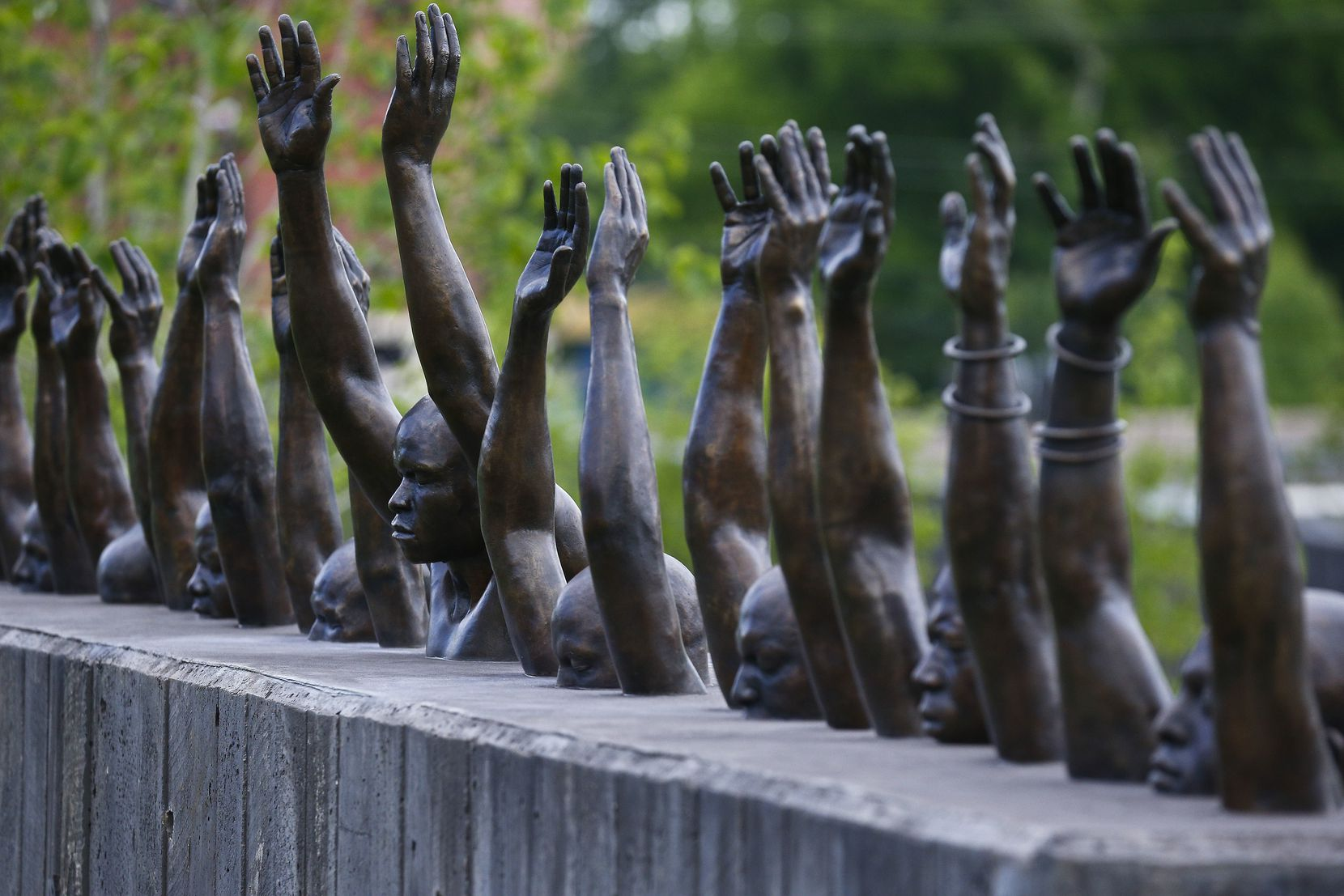 The bronze sculpture Raise Up by Hank Willis Thomas addresses police violence against African-Americans.