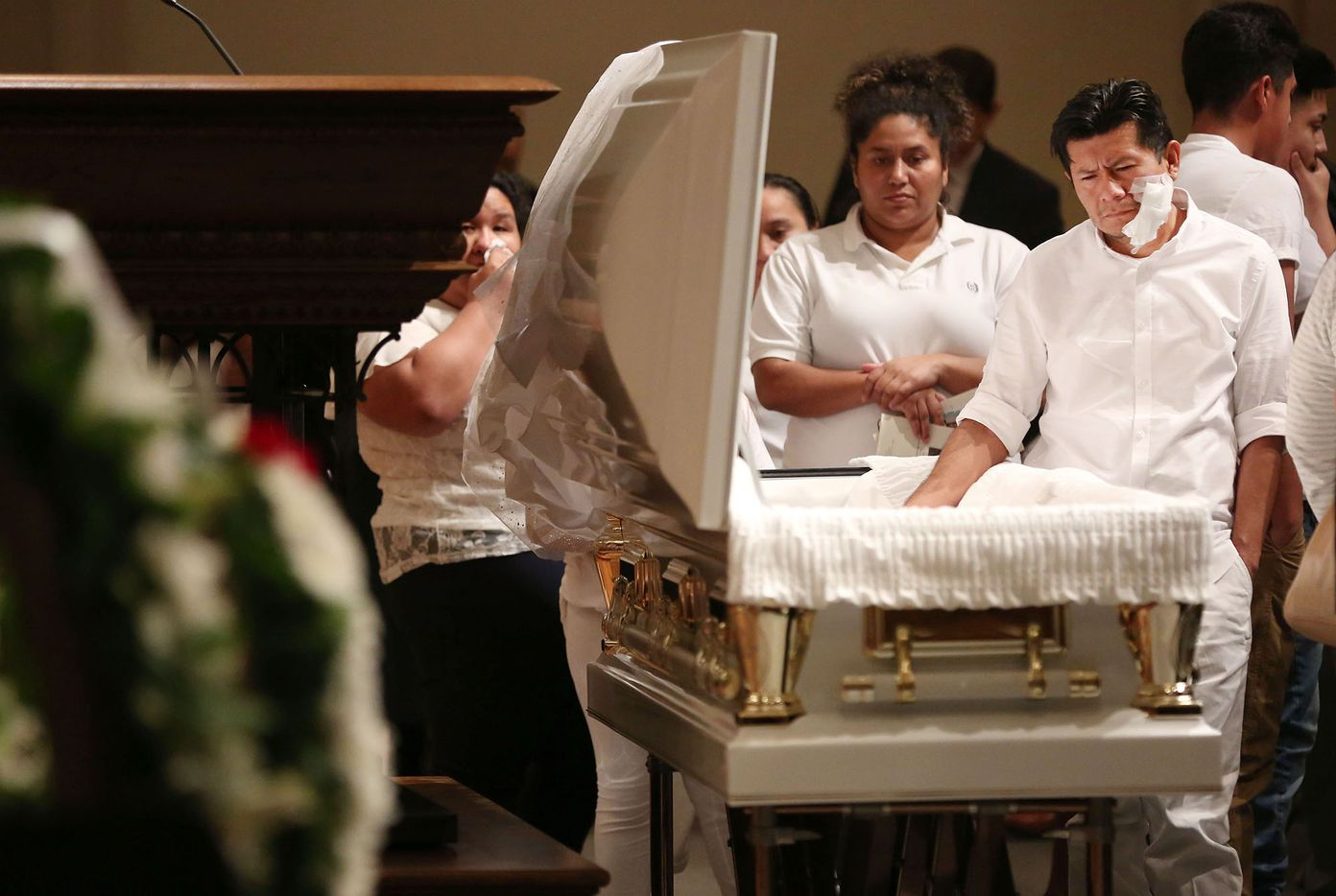 Jose Fiscal takes a moment with his deceased daughter, 12-year-old Linda Rogers, during her memorial service and viewing of  at Park Cities Presbyterian Church in Dallas on Thursday, March 1, 2018. Rogers was killed in a gas explosion at her home in Dallas.