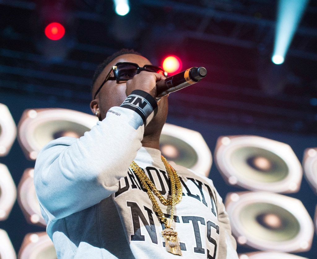 """In this Dec. 19, 2014, file photo, Troy Ave performs at """"Christmas in Brooklyn"""" at the Barclays Center in New York's Brooklyn borough. (Photo by Scott Roth/Invision/AP, File)"""