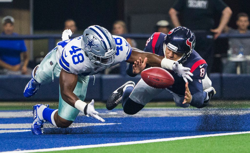 Dallas Cowboys linebacker Joe Thomas (48) and Houston Texans punter Trevor Daniel (8) dive for a loose ball in the end zone after Thomas blocked a punt by Daniel during the first quarter of an NFL game between the Dallas Cowboys and the Houston Texans on Saturday, August 24, 2019 at AT&T Stadium in Arlington. Thomas recovered the ball in the end zone for a touchdown. (Ashley Landis/The Dallas Morning News)