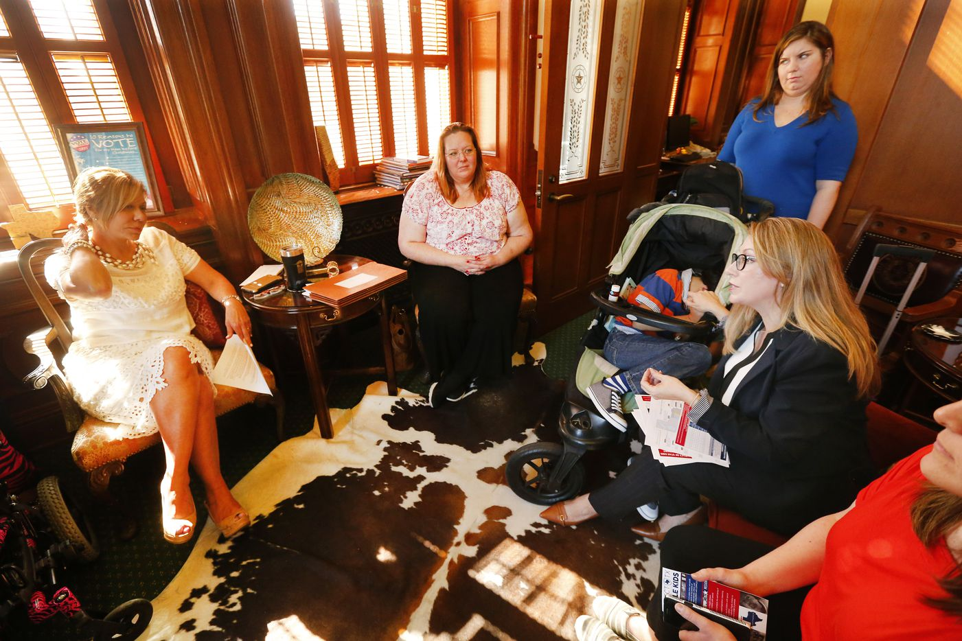 Republican state Sen. Joan Huffman (left) visits with mothers of medically fragile children including Cheevers, Mehta and Amber Marin (far right) of Sugar Land in her Capitol office.