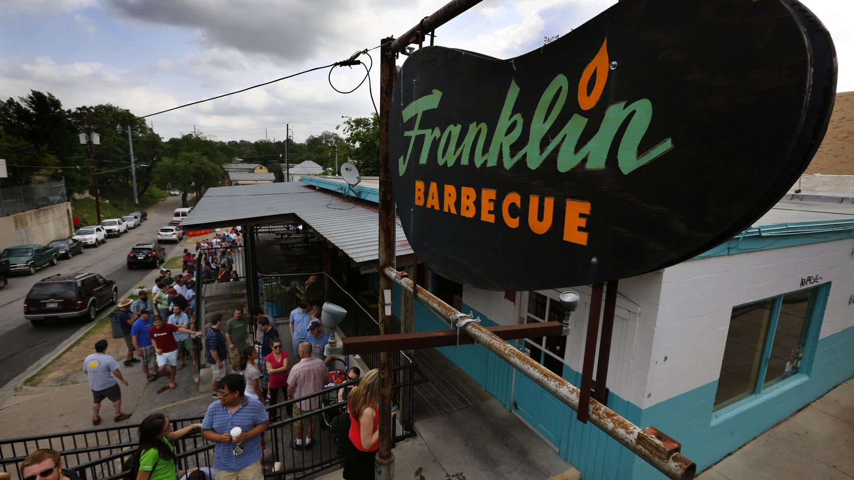 Long lines typically form outside Franklin Barbecue in Austin because of its popularity. .