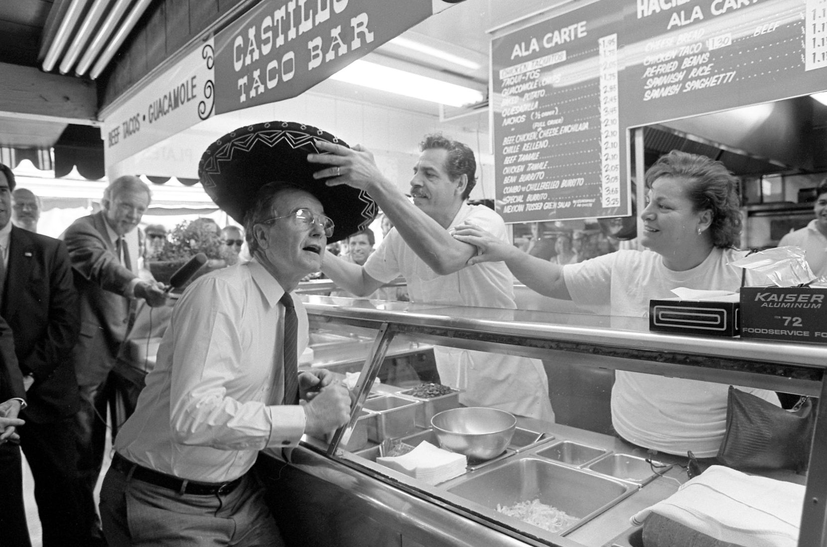 1988: Vice President George Bush dons a sombrero while campaigning at the Farmers Market in Los Angeles.